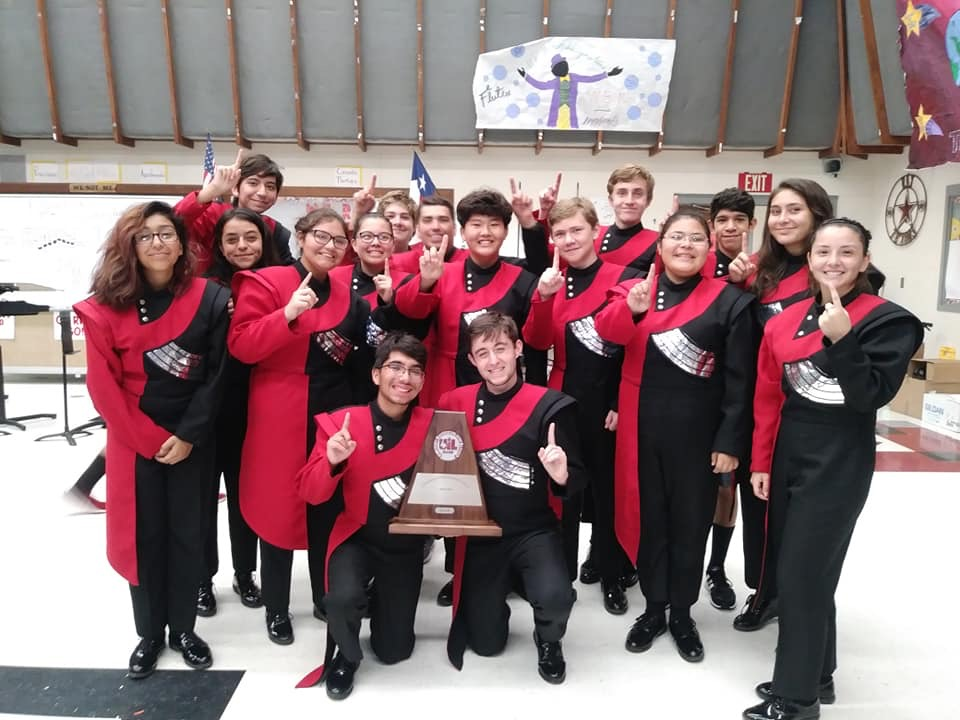 Trumpet Section Holding the Division 1 Trophy