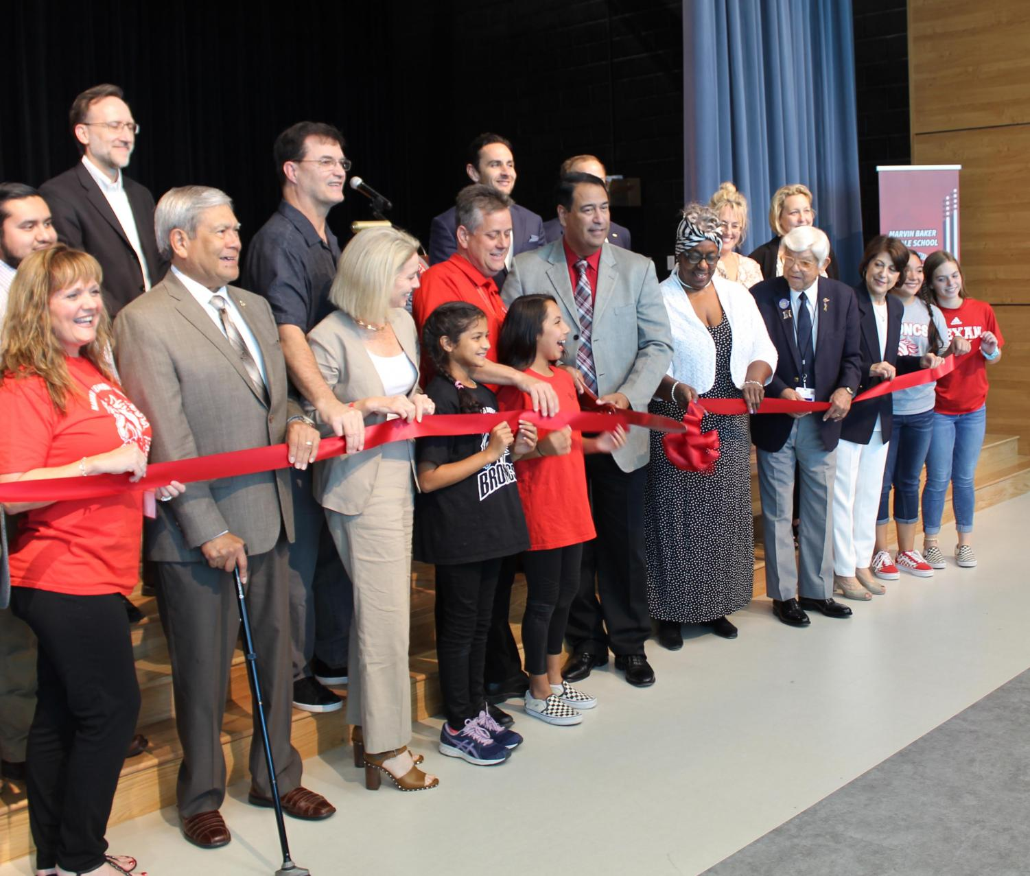CCISD School Board members and other dignitaries participate in the ribbon-cutting for the new Baker Middle School building on October 10.